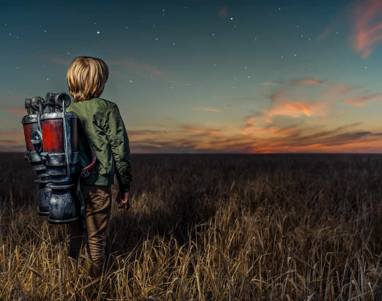 Creative marketing vs marketing data - image of boy in field with backpack
